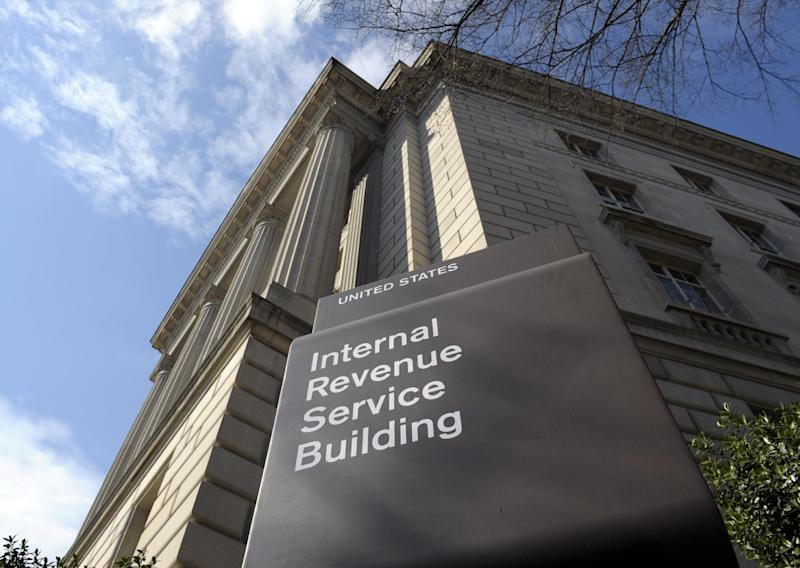 FILE - This March 22, 2013 file photo shows the exterior of the Internal Revenue Service building in Washington. No one answered the phone at the IRS hotline for tax help. Forget about advice on avoiding foreclosures at one of the Housing and Urban Development offices nationwide. Roughly five percent of the federal workforce _ 115,000 people at six government agencies _ got an unpaid day off on Friday due to the automatic cuts to the government budget. The furloughs forced some agencies such as the IRS and HUD to drastically scale back operations.  (AP Photo/Susan Walsh, File)