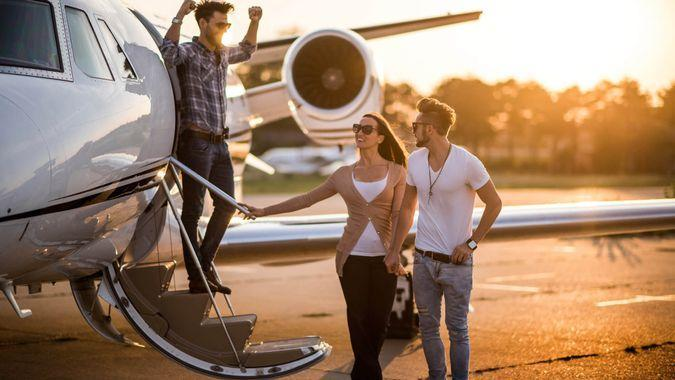 friends getting off airplane