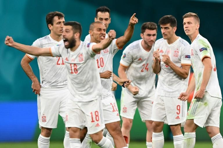 Spain players celebrate beating Switzerland on penalties in the Euro 2020 quarter-finals