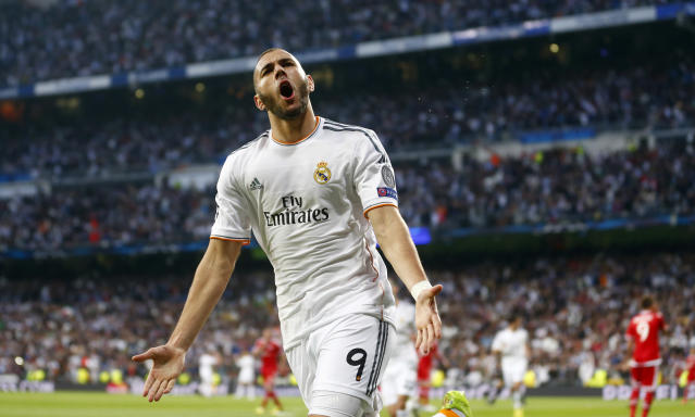 Real's Karim Benzema celebrates scoring the opening goal during a Champions League semifinal first leg soccer match between Real Madrid and Bayern Munich at the Santiago Bernabeu stadium in Madrid, Spain, Wednesday, April 23, 2014. (AP Photo/Paul White)