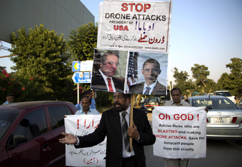In this Monday, Oct. 21, 2013 photo, Pakistani Christian leader J. Salik chants slogans as he marches demanding the end to U.S. drone attacks at hideouts of militants in Pakistani tribal areas, in Islamabad, Pakistan. Amnesty International calls on the U.S. to investigate reported civilian casualties from CIA drone strikes in Pakistan and compensate victims in a report providing new details about innocent citizens allegedly killed in the attacks. (AP Photo/B.K. Bangash)