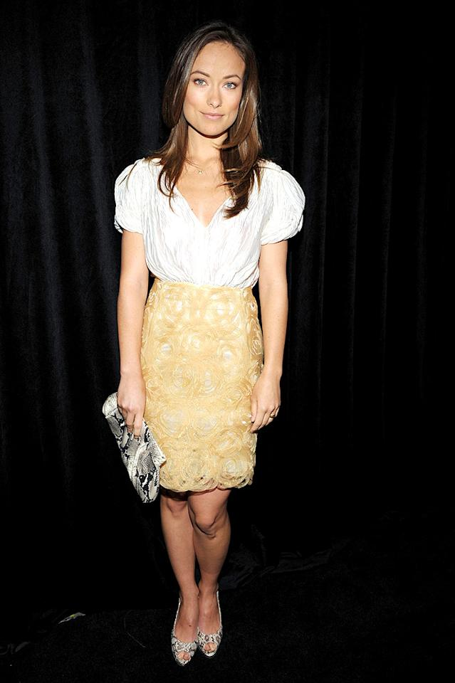 """Also looking lovely was Olivia Wilde, who paired her plunging blouse with a sensational skirt, snakeskin heels, and a matching clutch. John Shearer/<a href=""""http://www.wireimage.com"""" target=""""new"""">WireImage.com</a> - January 14, 2010"""