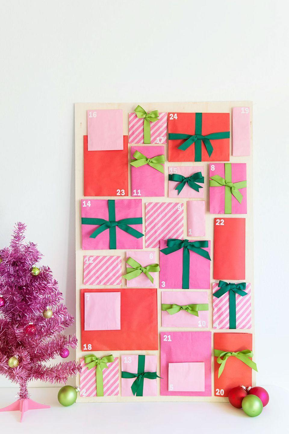 "<p>We're not just trying to make fetch happen here—pink can look totally festive. This DIY advent calendar is made out of red and pink paper bags.</p><p>Get the tutorial at <a href=""https://tellloveandparty.com/2016/12/diy-paper-bag-advent-calendar.html"" rel=""nofollow noopener"" target=""_blank"" data-ylk=""slk:Tell Love and Party"" class=""link rapid-noclick-resp"">Tell Love and Party</a>. </p>"