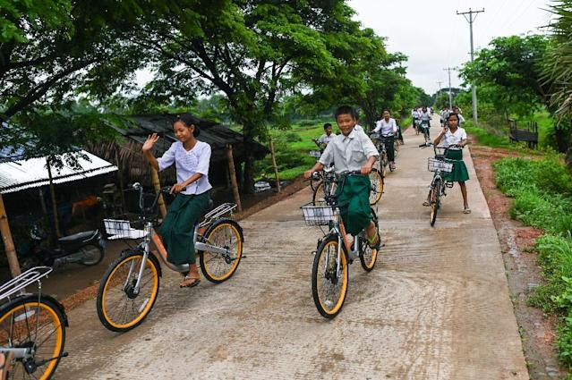 Lesswalk hopes the bikes will help keep more kids in school for longer, giving them an education so they can escape from poverty (AFP Photo/Ye Aung THU)