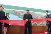 "ADDS CITY AND ID OF WOMAN - In this Friday, May 1, 2020, photo provided by the North Korean government, North Korean leader Kim Jong Un, center, cuts a tape, watched by his sister Kim Yo Jong, during his visit to a fertilizer factory in Sunchon, South Pyongan province, near Pyongyang, North Korea. Kim made his first public appearance in 20 days as he celebrated the completion of the fertilizer factory, state media said Saturday, May 2, 2020, ending an absence that had triggered global rumors that he may be seriously ill. Independent journalists were not given access to cover the event depicted in this image distributed by the North Korean government. The content of this image is as provided and cannot be independently verified. Korean language watermark on image as provided by source reads: ""KCNA"" which is the abbreviation for Korean Central News Agency. (Korean Central News Agency/Korea News Service via AP)"