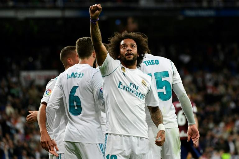 Real Madrid's Brazilian defender Marcelo celebrates after scoring his team's third goal during the Spanish league football match against Eibar at the Santiago Bernabeu stadium in Madrid on October 22, 2017