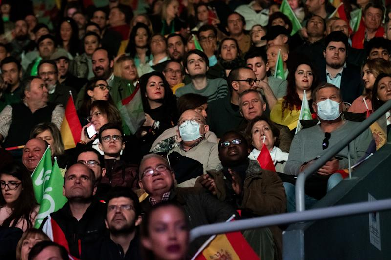 MADRID, SPAIN - 2020/03/08: Supporters of far-right party VOX some seen with protection masks (probably to protect from coronavirus contagion) during the 'Vistalegre III' rally, coinciding with the International Women's Day. (Photo by Marcos del Mazo/LightRocket via Getty Images)