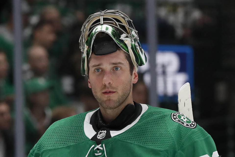 FILE - Dallas Stars goaltender Ben Bishop is shown during an NHL hockey game against the Vancouver Canucks in Dallas, in this Tuesday, Nov. 19, 2019, file photo. Stars goaltender Ben Bishop has waived his no-movement clause to be exposed in the Seattle expansion draft next week after approaching his team with the idea. The move, which the team confirmed Thursday, July 15, 2021, allows Dallas to protect veteran goalie Anton Khudobin from the Kraken. (AP Photo/Tony Gutierrez, File)