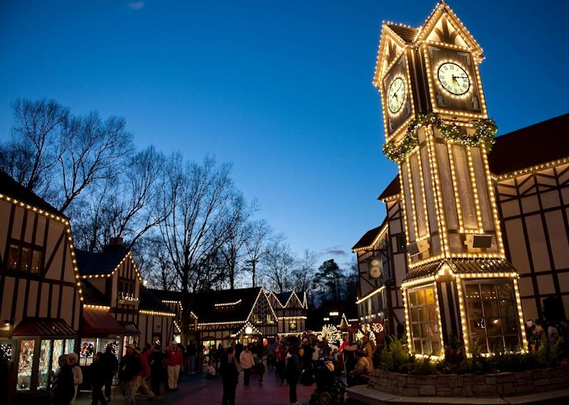 This Nov.2011 photo provided by Busch Gardens Williamsburg shows the theme park's Christmas Town, which returns this year for a fourth season, with six million lights adorning nearly every building. The display includes 1,500 trees, 700 wreaths and 20,000 ornaments, plus shows, Santa's workshop and a 50-foot-tall animated tree dancing to synchronized music. (AP Photo/SeaWorld Parks & Entertainment)