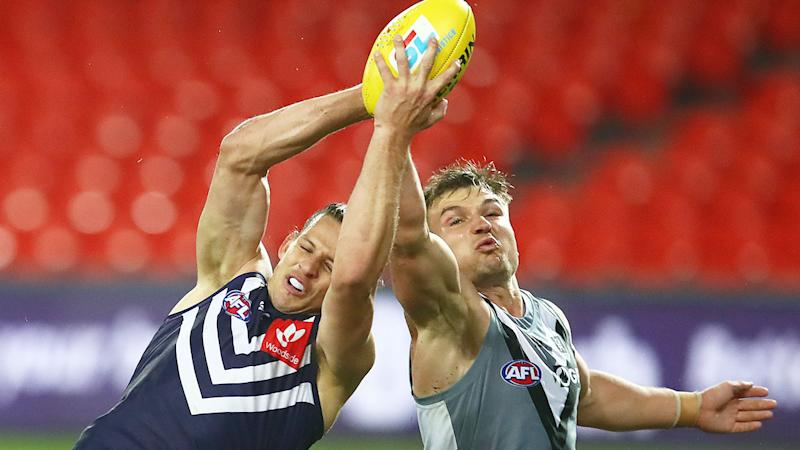 Pictured here, Nat Fyfe contests the footy in Fremantle's match action against Port Adelaide.