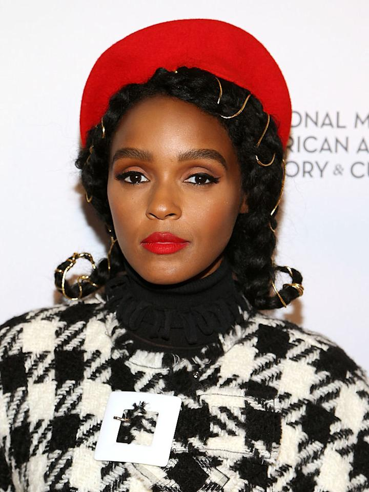 <p>For a screening of <i>Hidden Figures</i> at the National Museum of African American History & Culture in Washington, D.C., Monáe decorated her braids with golden ropes. (Photo: Getty Images) </p>