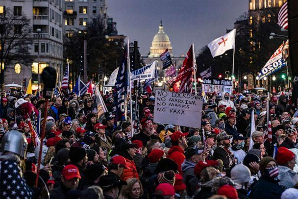 PHOTO: Supporters of President Donald Trump gather in the rain for a rally at Freedom Plaza, Jan. 5, 2021, in Washington, D.C., the day before a mob of Trump supporters stormed the Capitol following a rally with Trump. (Samuel Corum/Getty Images)