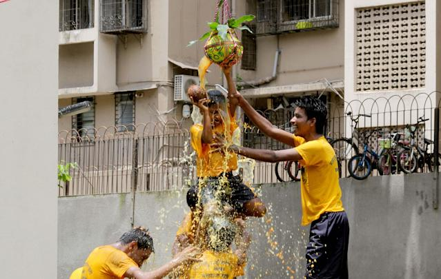 <p>A visually challenged child tries to break the Dahi handi an earthen pot filled with curd hung high, during celebrations to mark Janmashtami at the Victoria School for the Blind in Tardeo, on September 1, 2018 in Mumbai, India. (Photo by Bhushan Koyande/Hindustan Times via Getty Images) </p>