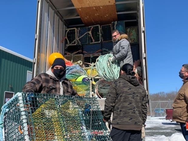 The Department of Fisheries and Oceans issued its position on the same day Sipekne'katik First Nation took back possession of more than 200 traps seized by DFO last fall. (Paul Withers/CBC - image credit)