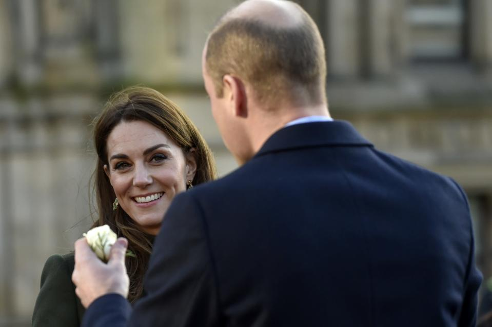 Kate Duchess of Cambridge smiles as Britain's Prince William holds a rose during their meeting with the members of the public at Centenary Square in Bradford northern England, Wednesday, Jan. 15, 2020. (AP Photo/Rui Vieira)