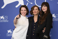 Olivia Colman, from left, Maggie Gyllenhaal and Dakota Johnson pose for photographers at the photo call for the film 'The Lost Daughter' during the 78th edition of the Venice Film Festival in Venice, Italy, Friday, Sep, 3, 2021. (AP Photo/Domenico Stinellis)