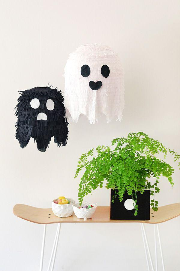 """<p>These adorable party decorations also contain a hidden stash of candy. Double the purpose, double the cuteness. </p><p><em><a href=""""http://makeandtell.com/diy-ghost-pinatas/"""" rel=""""nofollow noopener"""" target=""""_blank"""" data-ylk=""""slk:Get the tutorial at Make and Tell »"""" class=""""link rapid-noclick-resp"""">Get the tutorial at Make and Tell »</a></em> </p>"""