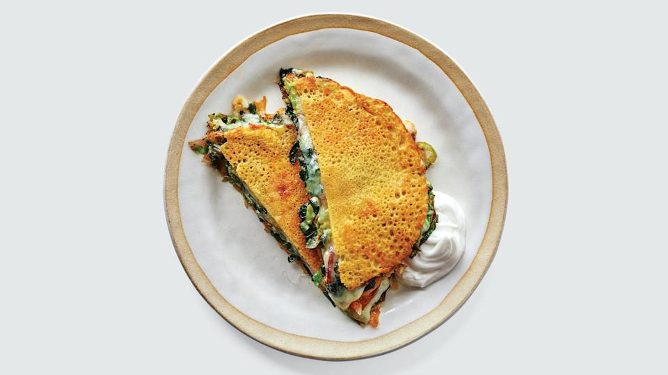 """<a href=""""https://www.bonappetit.com/recipe/chickpea-pancakes-with-greens-and-cheese?mbid=synd_yahoo_rss"""" rel=""""nofollow noopener"""" target=""""_blank"""" data-ylk=""""slk:See recipe."""" class=""""link rapid-noclick-resp"""">See recipe.</a>"""