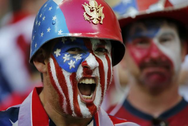 A U.S. fan cheers during the 2014 World Cup G soccer match between Portugal and the U.S. at the Amazonia arena in Manaus June 22, 2014. REUTERS/Siphiwe Sibeko (BRAZIL - Tags: SOCCER SPORT WORLD CUP)