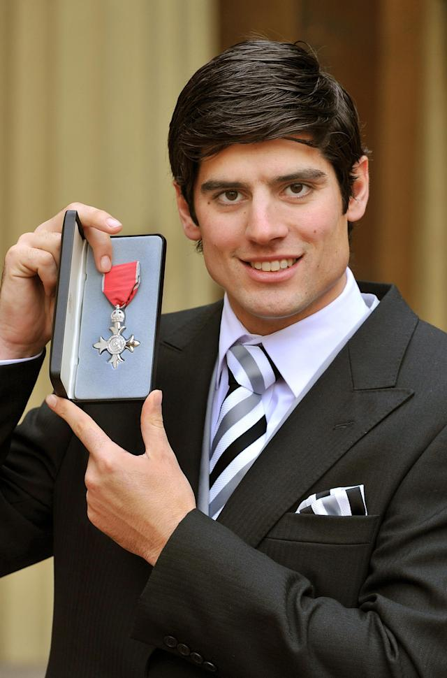 England cricketer Alastair Cook poses with his medal after he was made an MBE (Member of the Order of the British Empire) by Britain's Queen Elizabeth during an investiture ceremony at Buckingham Palace in London on December 6, 2011. England's Ashes hero Cook was presented with an MBE by the Queen for his outstanding performance against Australia during the famous cricket series. The opening batsman's prolific scoring helped the national team crush their opposition Down Under last winter earning England their first Ashes victory in Australia for 24 years. AFP PHOTO / POOL / JOHN STILLWELL (Photo credit should read JOHN STILLWELL/AFP/Getty Images)
