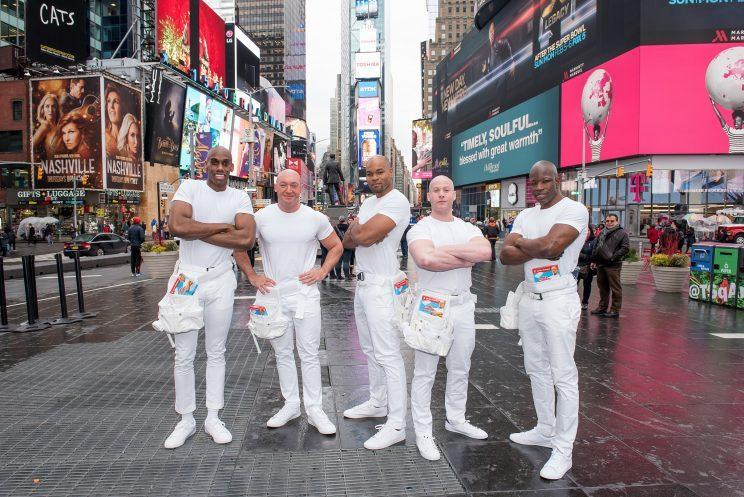 Winner of the the #NextMrClean contest Mike Jackson (C) and the Mr. Clean Sexy Dream Team celebrate Mr. Clean's first ever Super Bowl ad spot in Times Square. (Photo: Mike Pont/WireImage)