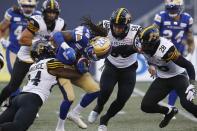 Winnipeg Blue Bombers wide receiver Janarion Grant (80) is tackled by Hamilton Tiger-Cats' Desmond Lawrence (24) during the first half of a Canadian Football League game Thursday, Aug. 5, 2021, in Winnipeg, Manitoba. (John Woods/The Canadian Press via AP)