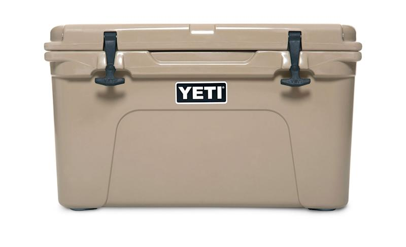 Beige ice cooler labeled Yeti.