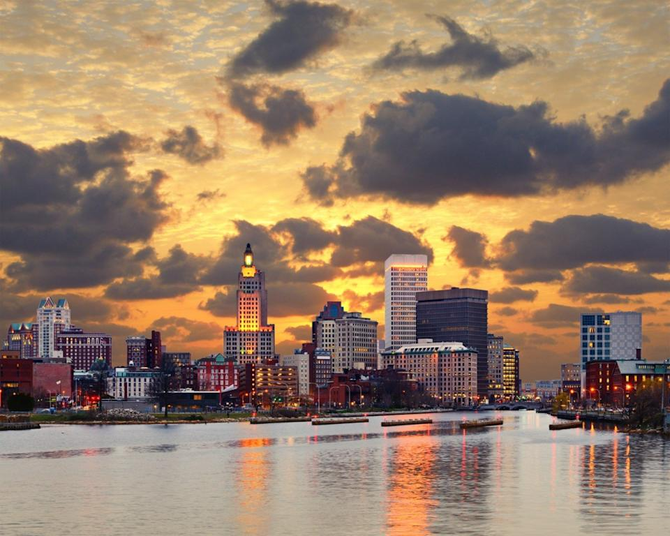 city skyline of and river in Providence, Rhode Island at sunset