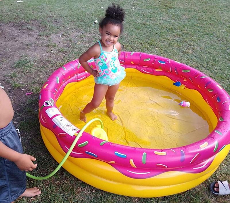 The little girl enjoying the inflatable pool the Wichita police officers bought for her. Source: Facebook/ Danielle Hutton