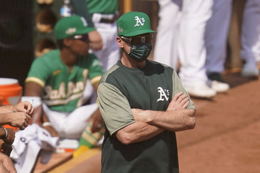 Oakland Athletics manager Bob Melvin watches during the second inning of Game 2 of an American League wild-card baseball series against the Chicago White Sox, Wednesday, Sept. 30, 2020, in Oakland, Calif. (AP Photo/Eric Risberg)