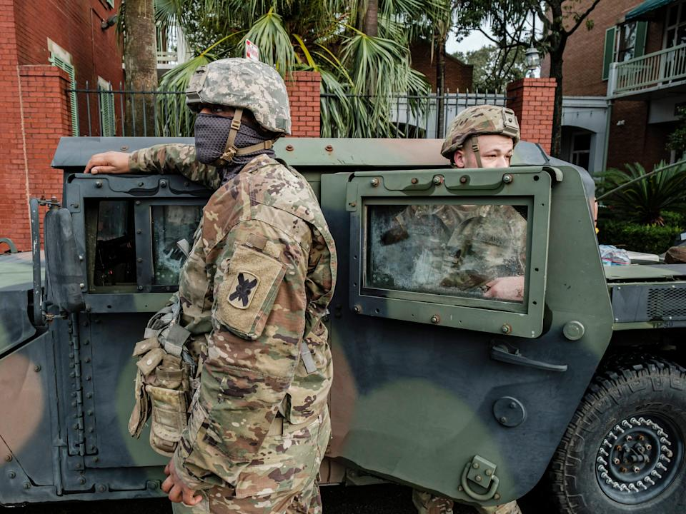 Members of the Louisiana National Guard stand outside their vehicles on North Rampart Street to help in Hurricane Ida recovery efforts (EPA)