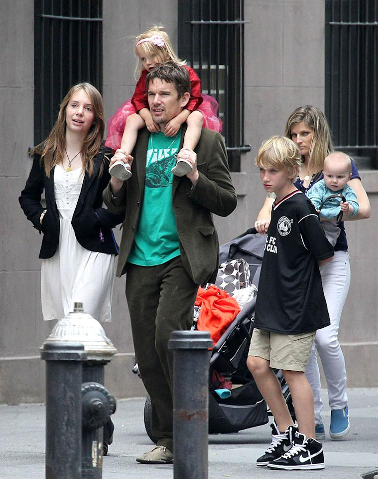 "<p class=""MsoNormal"">Ethan Hawke was surrounded by family on Father's Day. The actor was snapped with his two older children — Maya, 13, and Levon, 10 (whose mom is Uma Thurman) — as well as his two little ones with second wife Ryan Shawhughes: Clementine, 3, and Indiana, almost 1. The family did a little real estate hunting in New York City, checking out a townhouse that's on the market, then headed to the park. (6/17/2012) </p>"