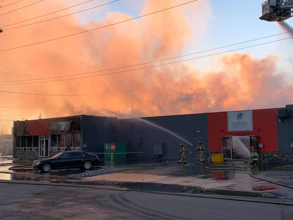 A commercial building in southeast Edmonton caught fire Friday morning. The Emmanuel Foundationand a thrift store housed in the buildingburned down as a result. (David Bajer/CBC - image credit)