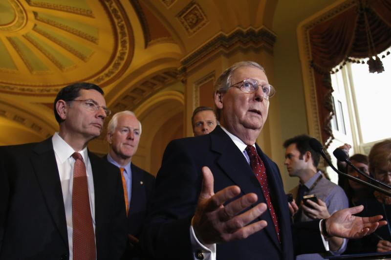 U.S. Senate Minority Leader Mitch McConnell (R-KY) speaks to the media following a Senate cloture vote on budget bill on Capitol Hill in Washington