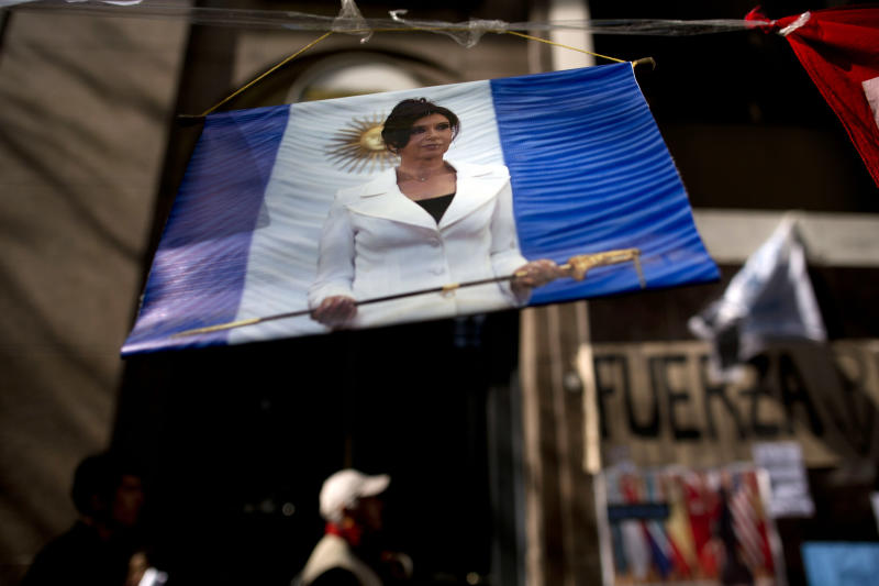 """A picture of Argentina's President Cristina Fernandez hangs outside the Favaloro Hospital where she is undergoing surgery on her skull months after she suffered an unexplained head injury in Buenos Aires, Argentina, Tuesday, Oct. 8, 2013. Fernandez was diagnosed with """"chronic subdural hematoma,"""" or fluid trapped between the skull and brain. Doctors initially prescribed a month's rest, but decided surgery was required after she complained of numbness and weakness in her upper left arm Sunday. (AP Photo/Natacha Pisarenko)"""