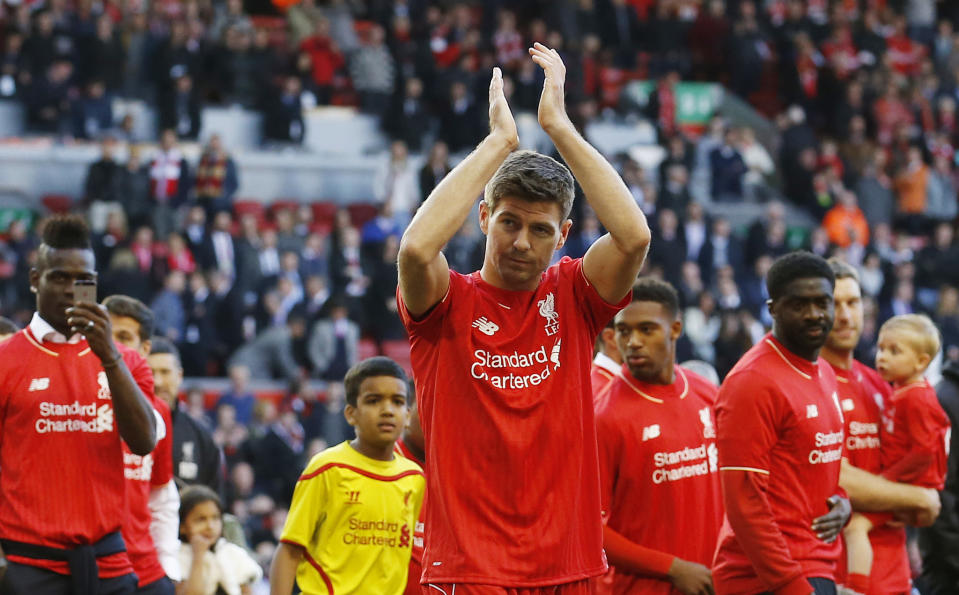 Liverpool's Steven Gerrard acknowledges the crowd as he walks on the pitch after his final game at Anfield.