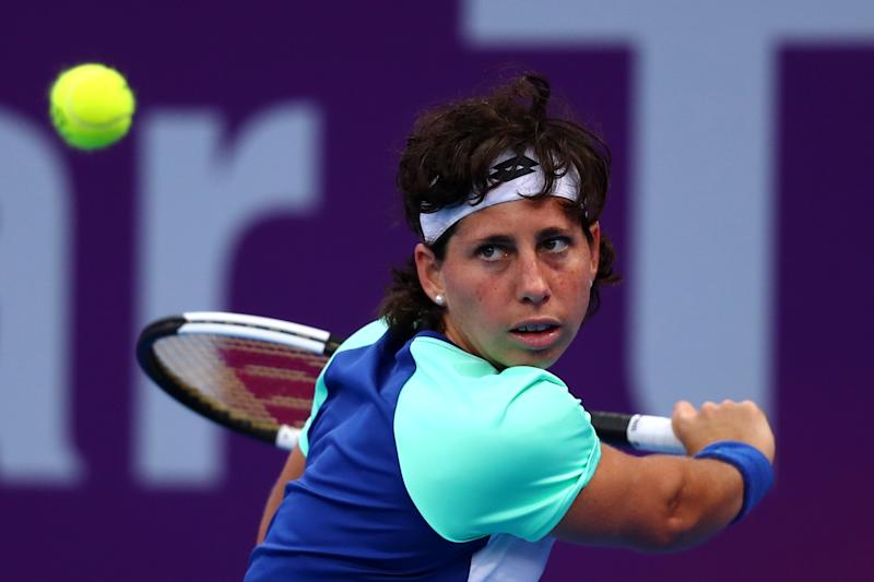 DOHA, QATAR - FEBRUARY 25: Carla Suarez Navarro of Spain returns a backhand against Petra Kvitova of Czech Republic during Day 3 of the WTA Qatar Total Open 2020 at Khalifa International Tennis and Squash Complex on February 25, 2020 in Doha, Qatar. (Photo by Dean Mouhtaropoulos/Getty Images)