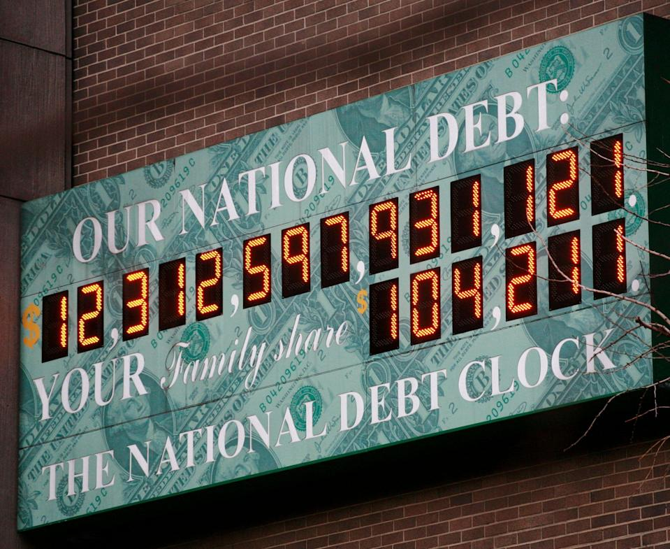 FILE - This Feb. 1, 2010, file photo shows the National Debt Clock in New York. The budget President Barack Obama submitted to Congress this month proposes record spending of $3.8 trillion for 2011. Taxes in next year's budget will support only $2.5 trillion of that spending, leaving $1.3 trillion to be borrowed. The Debt Clock is a privately funded estimate of the national debt. (AP Photo/Mark Lennihan, File)