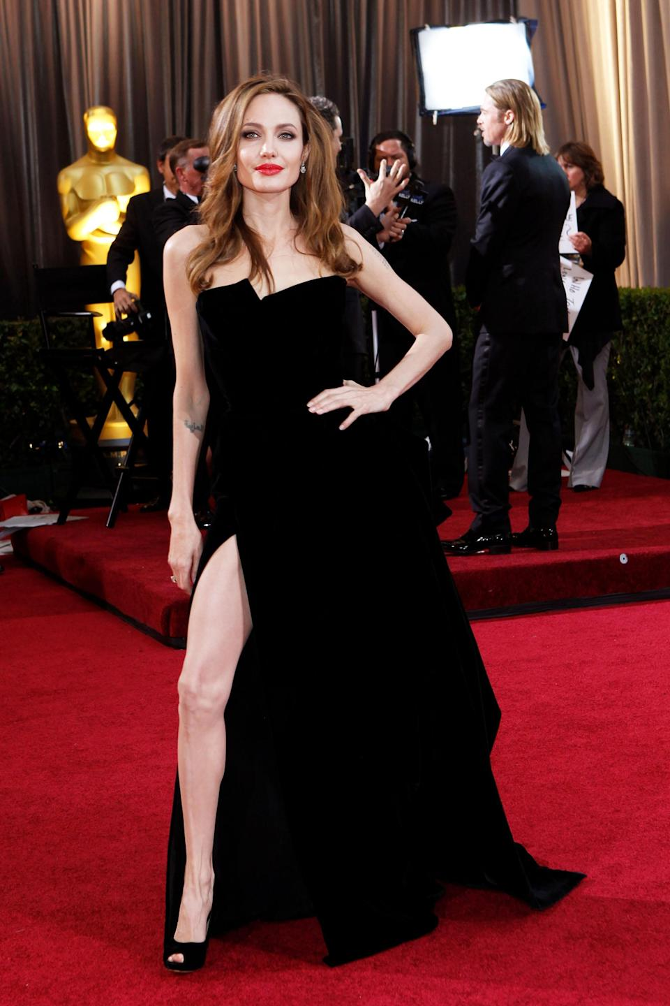 """<h2>Angelina Jolie, 2012</h2><br>No one does a high slit quite like Mrs. Smith herself, Angelina Jolie, who generated one of the greatest Oscar memes ever with this pose.<br><br><em>Angelina Jolie in Atelier Versace. </em><span class=""""copyright"""">Photo: Donato Sardella/WireImage/Getty Images. </span>"""