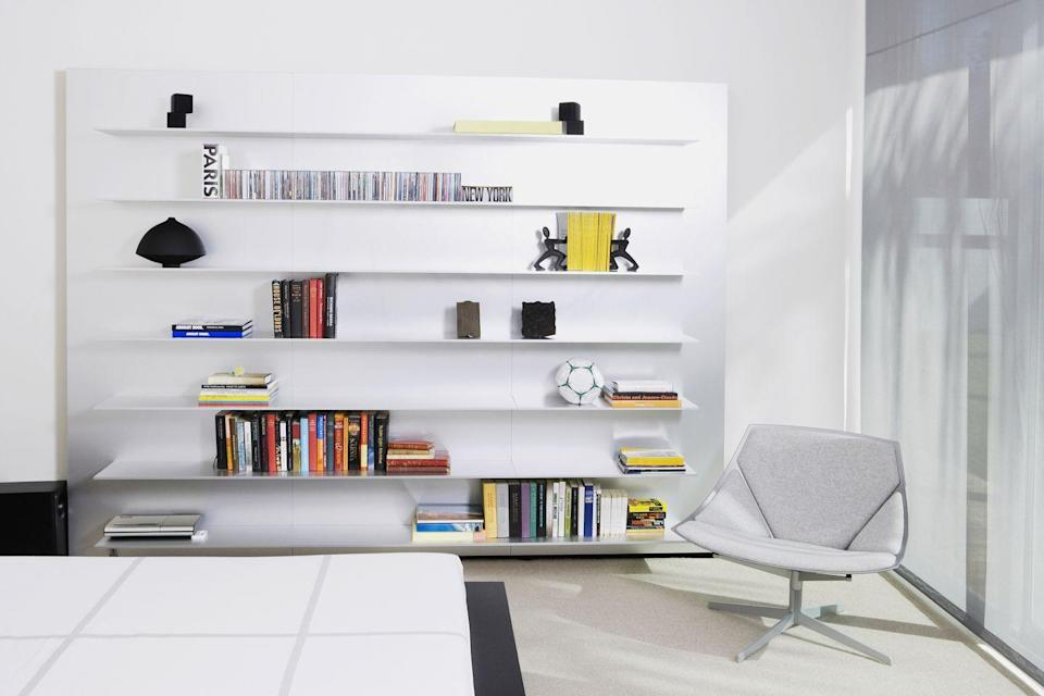 """<p>Bookshelves or partitions <a href=""""http://www.nytimes.com/2012/01/05/garden/not-much-natural-light-tips-to-make-your-place-look-brighter.html"""" rel=""""nofollow noopener"""" target=""""_blank"""" data-ylk=""""slk:should never be parallel"""" class=""""link rapid-noclick-resp"""">should never be parallel</a> to a window, or they'll obstruct the light. Carefully consider the flow of daylight and how you want to promote it. </p>"""