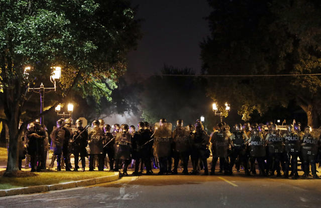 <p>Police line up as protesters gather, Friday, Sept. 15, 2017, in St. Louis, after a judge found a white former St. Louis police officer, Jason Stockley, not guilty of first-degree murder in the death of a black man, Anthony Lamar Smith, who was fatally shot following a high-speed chase in 2011. (Photo: Jeff Roberson/AP) </p>