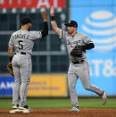 Chicago White Sox's Charlie Tilson, right, celebrates with Yolmer Sanchez (5) after the team's baseball game against the Houston Astros on Wednesday, May 22, 2019, in Houston. The White Sox won 9-4. (AP Photo/David J. Phillip)