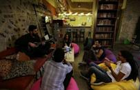 """Visitors play music and talk together in the bookshop where the new """"scream room"""" is found, in Cairo, Egypt October 23, 2016. REUTERS/Mohamed Abd El Ghany"""