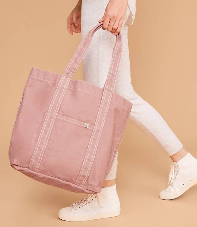 """<p>This <a href=""""https://www.popsugar.com/buy/Lou%20%26amp%3B%20Grey%2012-Hour%20Bag-471664?p_name=Lou%20%26amp%3B%20Grey%2012-Hour%20Bag&retailer=louandgrey.com&price=49&evar1=fab%3Auk&evar9=46413162&evar98=https%3A%2F%2Fwww.popsugar.com%2Ffashion%2Fphoto-gallery%2F46413162%2Fimage%2F46413789%2FLou-Grey-12-Hour-Bag&list1=shopping%2Ctravel%2Cbags%2Ctravel%20style&prop13=api&pdata=1"""" rel=""""nofollow"""" data-shoppable-link=""""1"""" target=""""_blank"""" class=""""ga-track"""" data-ga-category=""""Related"""" data-ga-label=""""https://www.louandgrey.com/the-12-hour-bag/498664"""" data-ga-action=""""In-Line Links"""">Lou &amp; Grey 12-Hour Bag</a> ($49) comes in so many cute colors.</p>"""