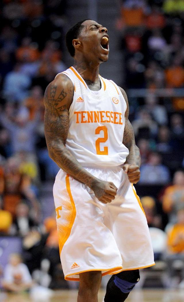 Tennessee's Antonio Barton reacts after hitting a basket to help Tennessee gain the lead over South Carolina-Upstate during the second half of an NCAA college basketball game in Knoxville, Tenn., Saturday, Nov. 16, 2013. Tennessee won 74-65. (AP Photo/Knoxville News Sentinel, Amy Smotherman Burgess)