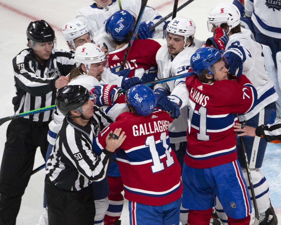 Montreal Canadiens and Toronto Maple Leafs players mix it up after the whistle during the second period of Game 6 of an NHL hockey Stanley Cup first-round playoff seres Saturday, May 29, 2021, in Montreal. (Ryan Remiorz/The Canadian Press via AP