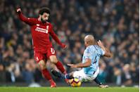 Vincent Kompany is only yellow carded after a lunge at Mo Salah. Manchester City win the game and the title. (3 January 2019)