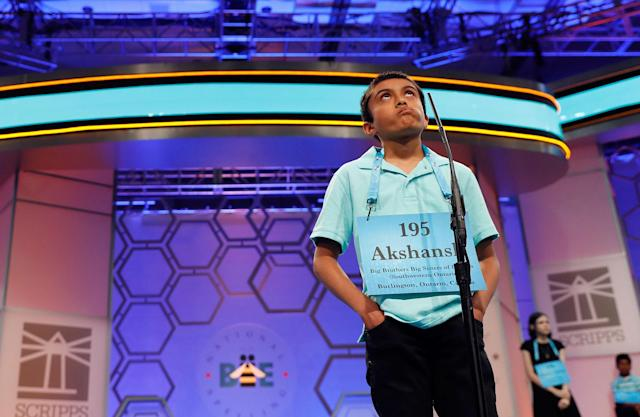 <p>Akshansh Ajay Kumar, 11, from Kitchener, Ontario, Canada, ponders his word during the 90th Scripps National Spelling Bee, Wednesday, May 31, 2017, in Oxon Hill, Md. (AP Photo/Alex Brandon) </p>