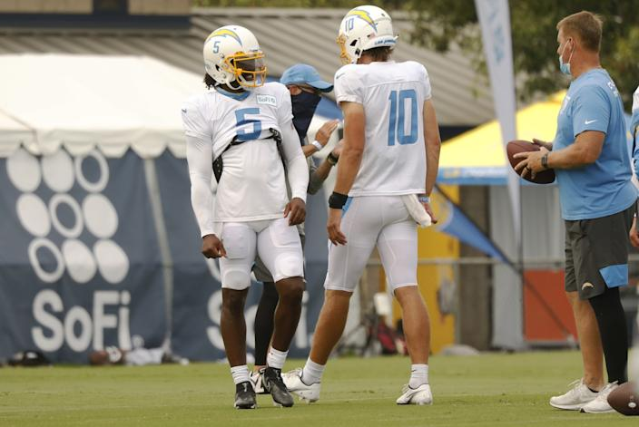 "Chargers quarterback Justin Herbert works with quarterback Tyrod Taylor as the team conducts practice at the Hammett Sports Complex in Costa Mesa on Aug. 17. <span class=""copyright"">(Al Seib / Los Angeles Times)</span>"