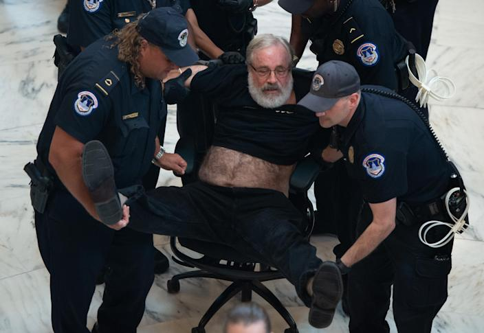 U.S. Capitol Police arrest a demonstrator during one of the Capitol Hill protests of Kavanaugh's nomination. (Photo: Saul Loeb/AFP/Getty Images)